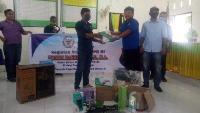 Photo of Anggota DPR RI Martin Manurung Salurkan Bantuan di Labura